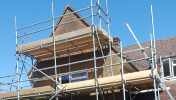 Scaffolding erected around a house in Haslemere
